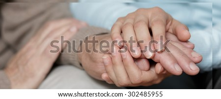 Horizontal view of caring about old person - stock photo