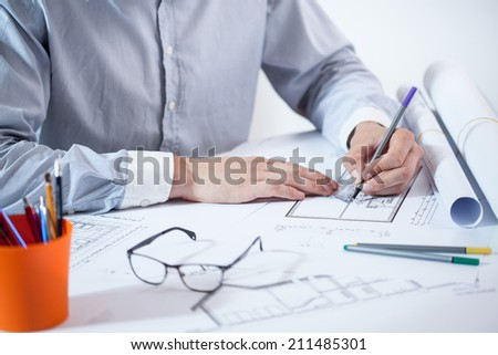 Horizontal view of close-up of working architect - stock photo