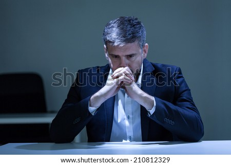 Horizontal view of depression in the office - stock photo