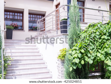 Horizontal view of exterior front stair design - stock photo