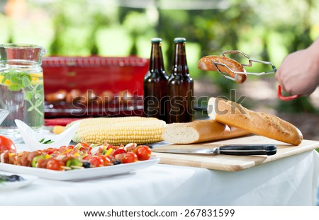Horizontal view of grill in the garden - stock photo