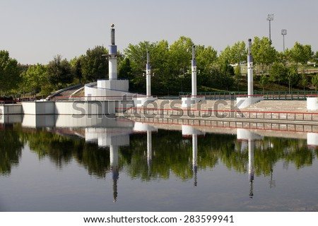 Horizontal view of highlights in a pond in a modern park. Pond in a Park. - stock photo