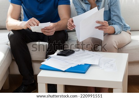 Horizontal view of marriage analyzing the bills - stock photo