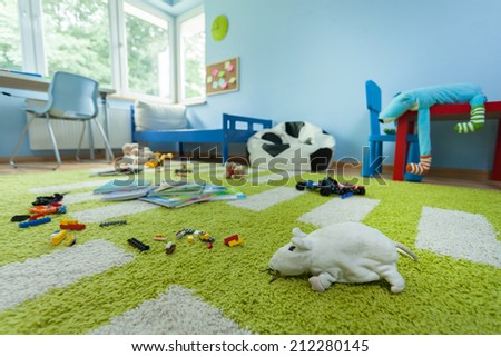 Horizontal view of mess in kids room - stock photo