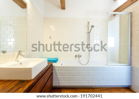 Horizontal view of modern and designed bathroom - stock photo