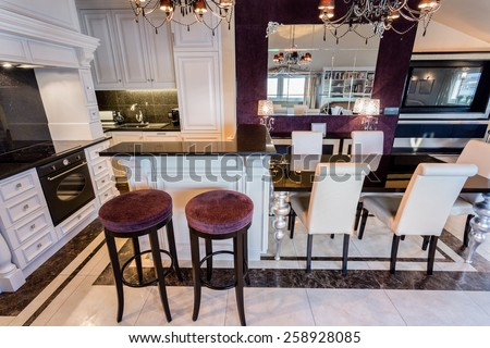 Horizontal view of modern glamour interior with violet details - stock photo