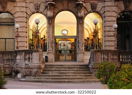 Horizontal view of old building facade, shot straight on to the entrance.  Location: Como, Italy.