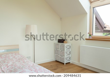 Horizontal view of part of bright bedroom - stock photo