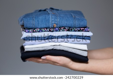 Horizontal view of perfect ironed female clothes - stock photo