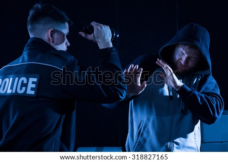 Horizontal view of police officer and lawbreaker - stock photo