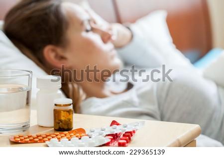 Horizontal view of sick woman sleeping in bedroom - stock photo