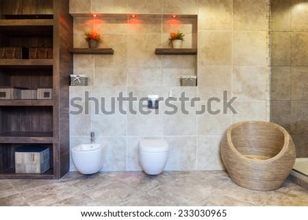 Horizontal view of spacious bathroom with closet - stock photo