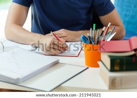 Horizontal view of student during doing homework - stock photo