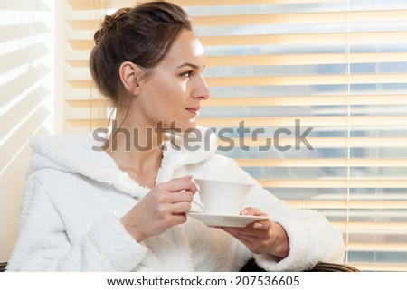 Horizontal view of woman drinking tea in spa
