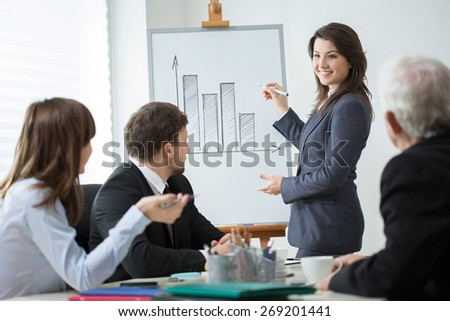 Horizontal view of woman leading business conference - stock photo