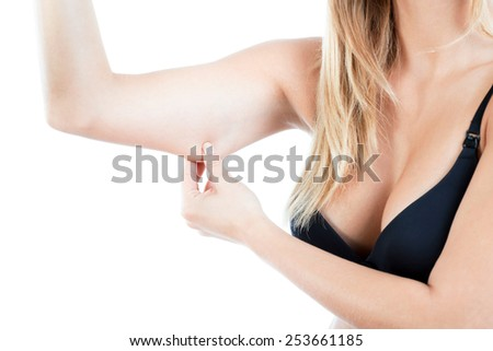 Horizontal view of woman showing flabby arm - stock photo