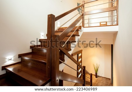 Horizontal view of wooden stairs at home - stock photo