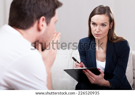 Horizontal view of young man during psychotherapy - stock photo