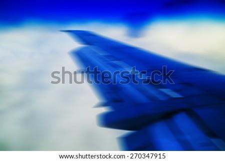 Horizontal vivid blue travel plane jet wing abstraction transportation background backdrop - stock photo