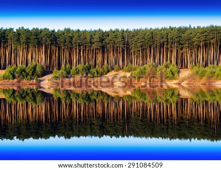 Horizontal vivid river side dramatic forest reflection background backdrop - stock photo