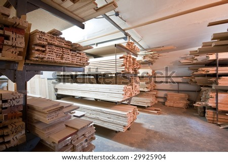 Horizontal wooden planks lie on a storage