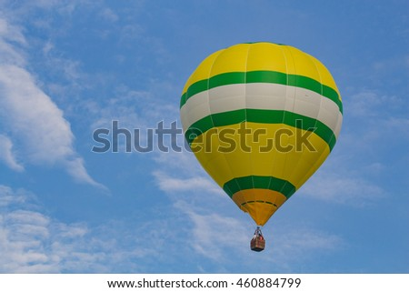 Horizontal Yellow Green and White Striped Hot Air Balloon Ascending