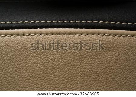 horizontally seam black and creamy leather - stock photo