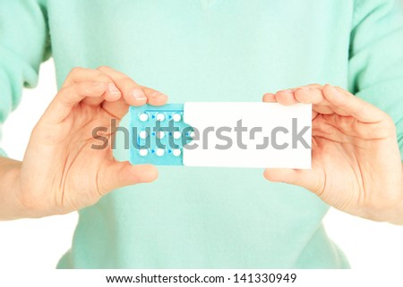 Hormonal pills in female  hands isolated on white - stock photo