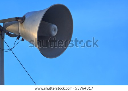 Horn loudspeaker on blue sky background - stock photo
