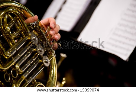 Horn player - stock photo