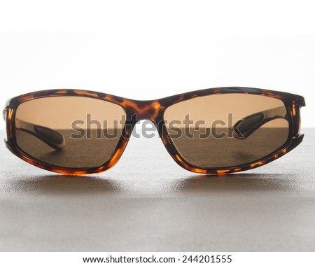 Horn rim sunglasses on a surface/Sunglasses/Product photo of a pair glasses - stock photo