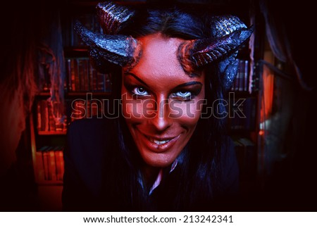 Horned Devil smiling at camera. Fantasy. Ancient style. Halloween.