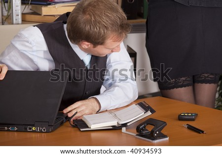 horny businessman looking at woman legs in a office - stock photo