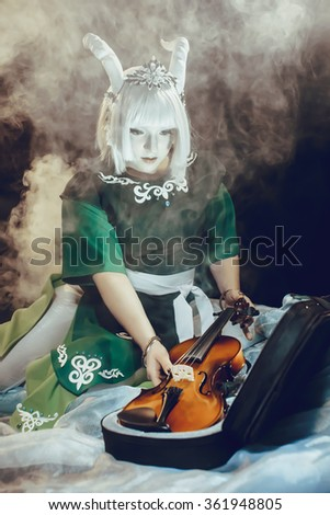 Horny girl pulls out violin - stock photo