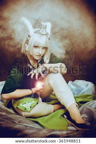 Horny girl with a magic ball - stock photo