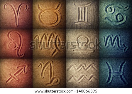 Horoscope signs written in the sand - stock photo
