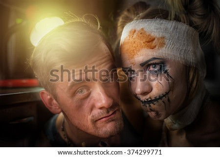 Horrible girl with her boyfriend, zombie halloween theme