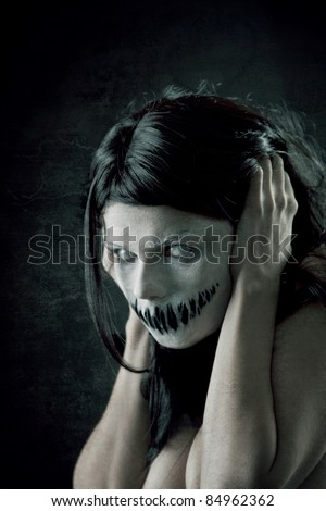 Horrible girl with scary mouth and eyes, extreme body-art - stock photo