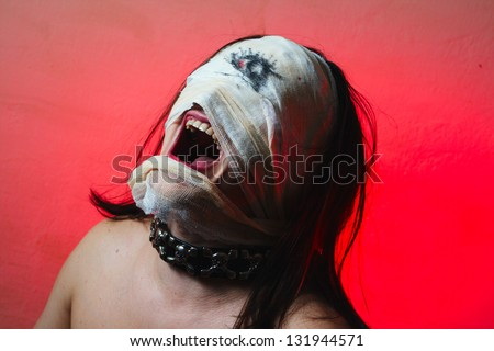 Horrible guy with scary mouth and one eye, schizophrenia - stock photo