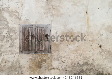 Horrible window on old cracked wall - stock photo