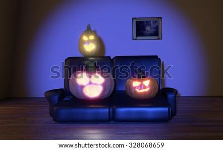 horrified pumpkins watching tv at night - stock photo