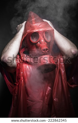 Horror, A man in a gas mask over  the smoke. black background and red colors