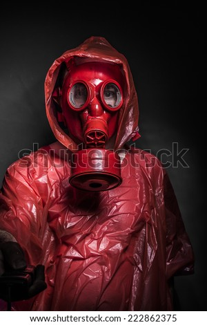 Horror, A man in a gas mask over  the smoke. black background and red colors - stock photo