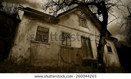 Horror - abandoned house at the rain, sepia filter - stock photo
