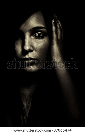 horror expression dark young girl face - stock photo