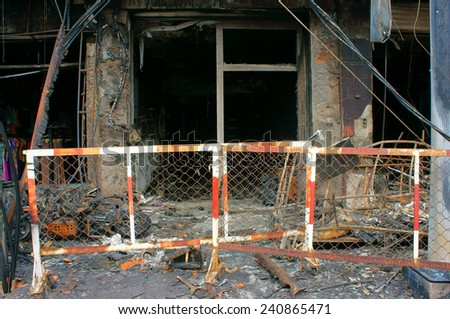 Horror fire at residence in Ho Chi Minh city, Vietnam, burned house, store damaged, melted in ash, only frame, an fearful acctident with serious loss - stock photo