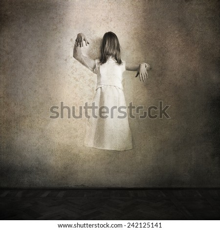 Horror movie scene with ghost girl coming through the wall - stock photo