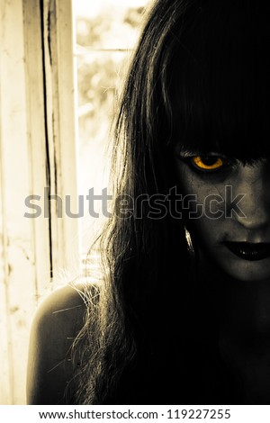 Horror portrait of a scary woman - stock photo