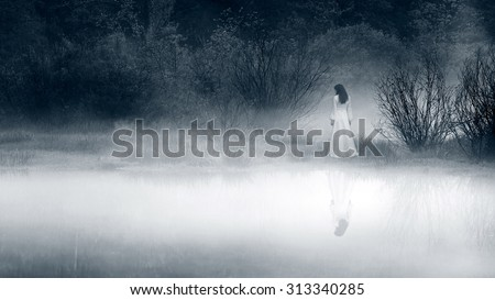 Horror scene of a scary woman. Black and white filter. - stock photo