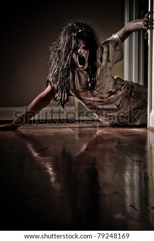 Horror Scene of a Woman Possessed Crawling Out of a bedroom down a hallway - stock photo